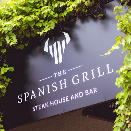 The Spanish Grill Steakhouse and Bar sign